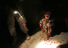 Chris Hondros—Getty Images Samar Hassan, 5, screams after her parents were killed by U.S. Soldiers with the 25th Infantry Division in a shooting January 18, 2005 in Tal Afar, Iraq. The troops fired on the Hassan family car when it unwittingly approached them during a dusk patrol in the tense northern Iraqi town. Parents Hussein and Camila Hassan were killed instantly, and a son Racan, 11, was seriously wounded in the abdomen. Racan, paralyzed from the waist down, was treated later in the…