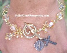 Beautiful aqua blue reminds me of Our Blessed Mother. As a gemstone each bead has a unique swirl of colors. Wire-wrapped to last a lifetime. Take Our Blessed Mother and Jesus with you wherever you go with this one decade rosary bracelet. The Antiqued Brass plated (lead-free) pewter accents add a vintage look. Great to wear with gold. This MAY TAKE 1-4 WEEKS FOR THIS TO BE COMPLETED. It may take less time depending upon what supplies are on hand. Let me know if you need a rush on this, and I…