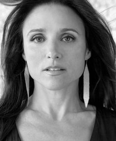 Julia Louis-Dreyfus is so pretty, but they always made her look so uglied up! Her clothes were so awful in the Seinfeld series. But, she has a great face and AWESOME hair.