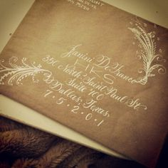 calligraphy-envelope-vienna-and-austin-flourished-white-ink-on-kraft.jpg