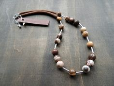 Pretty mookaite gemstones for this necklace. Combined them with tiny silver tubes and finished with with light chocolate brown fine crochet tubes.