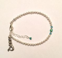 A personal favorite from my Etsy shop https://www.etsy.com/listing/512008977/childs-mermaid-pearl-bracelet