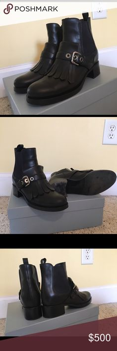 Prada kiltie black leather Moto boots size 7 37 Love these but they are too narrow for me. They are a 37 and I'm a 37.5. Fits like a TRUE size 7! If you're a 6.5 and want to wear them with thick winter socks that works also. Upper is in perfect condition, and soles are minimally marked (see photo). Stacked heel gives you a touch of height but the comfort of a walking shoe. Original price was 1100. Comes with duster bags and box. Prada Shoes Combat & Moto Boots