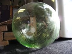 large green blown glass orb