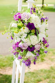Adding a bit of flower flair to the ends of the aisle can spruce up even the most simple of ceremony setups. Purple Wedding Flowers done beautifully. Photos by Clane Gessel Photography | #weddings #photography #flowers #weddingflowers