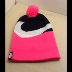 Nike hat youth size  pink black white This is a great Nike hat . Stocking,beanie cap Nike hat. Pink white and black. Youth size . Fits a normal adult head. Has ball on top. Ready to wear , Nike Accessories Hats