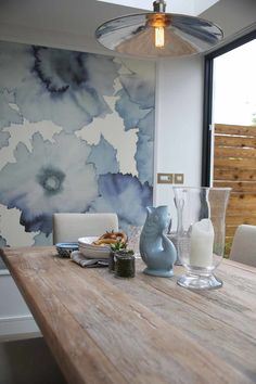 Interior design firm Natalia Design featured Bloom 7192-L Indigo on White Manila Hemp in the dining area of a client's home.