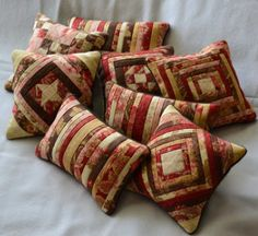 Michelle's Quilts & Stuff: Nice colour choices for the Schnibbles pincushions. Patchwork Cushion, Quilted Pillow, Small Quilts, Mini Quilts, Quilt Block Patterns, Quilt Blocks, Primitive Pillows, Quilted Gifts, Miniature Quilts