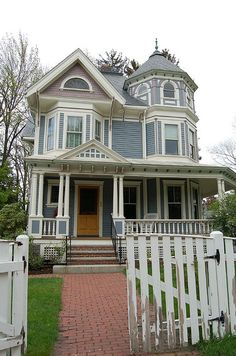 This is the most gorgeous house I have ever seen. The paint job is terrific - 4 colors, and the house still has the old slate roof with a cast iron widow''s walk on top.