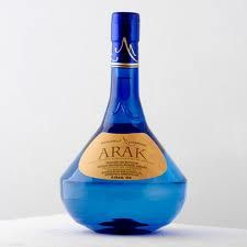 ARAK! the traditional liquer made from white grapes and anise it's 120 proof mix it with cold water it turn milky and goes great with all lebanese food.