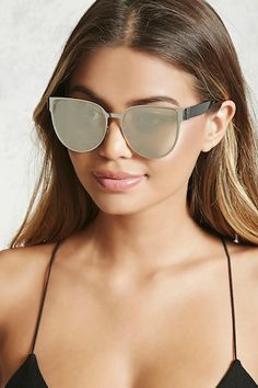 A pair of sunglasses featuring a cat eye design, mirrored lenses, a curved nose bridge, and matte temples.