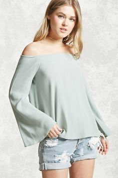 A crepe woven top featuring an elasticized off-the-shoulder neckline, long bell sleeves, and a flowy silhouette.  . . . is it just me, or does this girl totally look like Jewel?