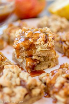 These Caramel Apple Pie Bars have gooey caramel apples sandwiched between a crumbly topping and a buttery crust all covered in even MORE homemade caramel.
