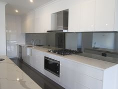 New Home, white kitchen, kitchen inspiration, new appliances, mirror splashback, black tiles, Paul Gray Builders, www.paulgraybuilders.com.au