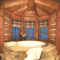 Circular tub in log bathroom