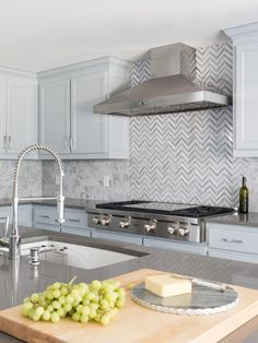 To add a snap of visual interest in this kitchen, the backsplash over the cooktop has a herringbone pattern.