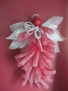 """Angel Wreath by TalkOfTheTownCreated on Etsy, $60.00 - Seller states: Red and Silver Angel Wreath. Each wreath is handmade and unique.....Would look beautiful hanging from a front door with a spot light on her. She measures approximately 32"""" long and is made of decomesh. If you plan on placing on an outside door please protect the wreath from the elements so you may enjoy the wreath for many years."""". Materials: Garland Wreath, Decomesh, Ornament, Mesh Tubing"""