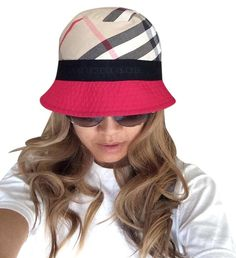 """Burberry hat like new , stripes and pink. Free shipping and guaranteed authenticity on Burberry hat like new , stripes and pinkBurberry hat like new, fit a 22"""" head , one size w..."""