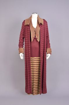 * LONG KNIT DRESS and COAT 1920s Long sleeve berry colored ribbed dress having long collar, wide cuff and lower skirt with patterned-knit gold bands, patterned knit coat with striped collar and cuff, single low novelty button.