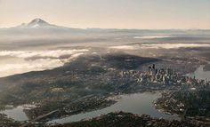 Aerial view of Seattle. Mount Rainier on the left, Downtown Seattle on middle right, Space Needle far middle right.what a sight ! The Places Youll Go, Places To See, Amsterdam, City From Above, Lake Union, Famous Places, Emerald City, Birds Eye View, Giza