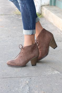 """The Shawna lace-up bootie, with an easy stacked heel, is the perfect, versatile style to add to your everyday wardrobe.Sizing: True to size. Taupe in color that is more brown than grey.- Round toe- Topstitching- Faux suede- Lace-up- Stacked print chunky heel- Approx. 3.5"""" shaft height- Approx. 3.75"""" heel- Imported"""