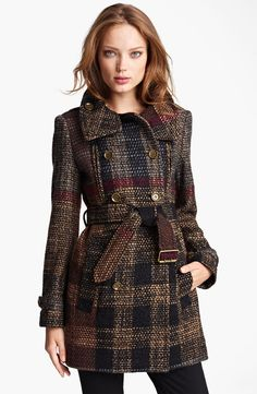Free shipping and returns on Burberry Brit Double Breasted Wool Blend Coat at Nordstrom.com. Exploded-scale checks subtly color a tweedy, double-breasted trench shaped with a convertible stand collar and a double-prong belt at the waist. Vertical zip pockets at the chest add a contemporary element, while logo-embossed buttons brand the look.