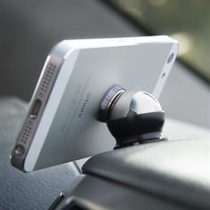The Ball Mobile Car Mount holds your phone or tablet hands-free on the dashboard. Versatile design allows freedom of use, while the strong spherical magnets and concave heat-resistant silicone mount securely to most surfaces. Radios, Iphone Car Mount, Best Car Phone Mount, Cell Phone Car Mount, Phone Deals, Car Gadgets, Travel Gadgets, Kids Gadgets, Iphone Gadgets
