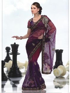 Get a gorgeous look in this brown saree. The saree is crafted in nett material. It has designer muti work all over the saree which gives it a gorgeous look. It is accompanied by a designer blouse which gives it a rich look.  (Slight variation in color is possible)