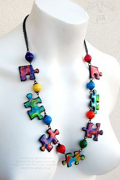 Puzzle Pieces Necklace ~ No info on this. I'm not sure if it's Polymer/Fimo clay or maybe even actual puzzle pieces with some type of material Mod Podged on? Paper Jewelry, Paper Beads, Enamel Jewelry, Polymer Clay Jewelry, Resin Jewelry, Jewelry Crafts, Jewelry Art, Beaded Jewelry, Handmade Jewelry