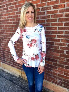 Light weight feminine and fun! Our Lillian Floral knit top is perfect transitional top for spring! Model is wearing a small. Runs true to size.   100% Rayon Hand Wash Cold.
