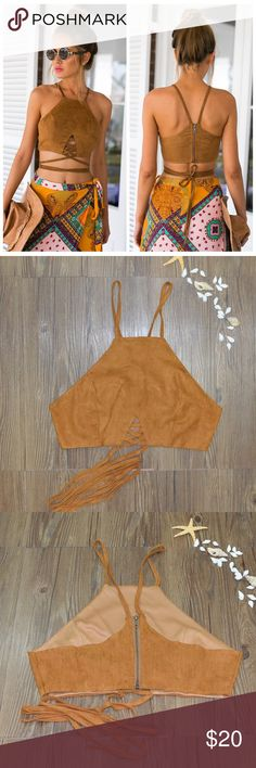 "Faux Suede Halter Crop Top Boho chic faux suede strappy halter crop top.  Has a high neckline and zippered back. Material does not have stretch.   Size small Bust: 31.5"" Length: 10.25"" Waist: 26.75""  Also available in black  Boutique Tops Crop Tops"