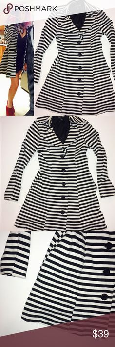Forever 21 long striped coat sz small EUC - worn a couple times . Once for Halloween as seen in the photo. Long black and white striped coat with pockets , buttons up , does almost a dress flare to it . Super cute , moving to Hawaii so all winter clothing is going! This is from forever 21 and has a tie belt included . Forever 21 Jackets & Coats