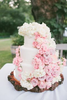 Wedding cake with cascading pink & white ombre flowers // Cake: All That Frost // http://www.theknot.com/submit-your-wedding/photo/dfc4e81b-1765-44d3-9013-c5548b947a37/Meet-The-Schneiders-Saddlerock-Ranch-Malibu-California-Wedding