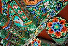 Korean temple - I'd love that flower as a tattoo ...I loved all the colors in the temples in South Korea. :)
