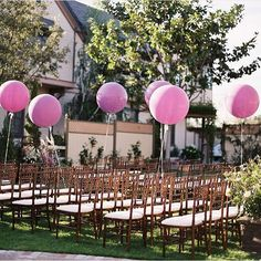 #WeddingCeremony #alegriabydesign! The #purpleballoons add a whimsical touch this ceremony #weddingchairs