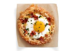 Breakfast in Bread: #FNMag challenged readers to come up with a name for this egg dish, and Breakfast in Bread was the perfect tagline. Eggs topped with bacon and cheese are served in puff pastry tart shells.