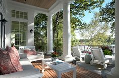 A gorgeous covered patio set off by columns in this shingle-style new home in Minnetonka, MN from architects TEA2