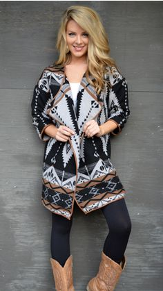 This coat is doing everything right! Shop our look book at www.bluedoorboutique.com/lookbook!