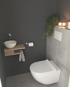 Stylish Bathroom Remodeling Ideas You'll Love is part of Small toilet room Low maintenance and easy to clean bathroom design can be pretty simple, for bith renovations and new homes Things you - Small Downstairs Toilet, Small Toilet Room, Guest Toilet, Downstairs Bathroom, Toilet With Sink, Wc Bathroom, Toilet Wall, Minimal Bathroom, Bathroom Modern