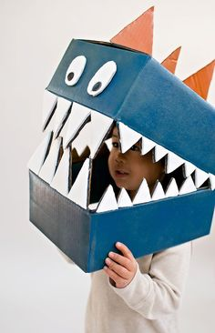 Cardboard boxes can quickly become this amazing DIY dinosaur costume.