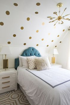 Transitional Bedroom by Lindye Galloway Design .  She  placed gold polka dot removable decals on all three angles of the ceiling.