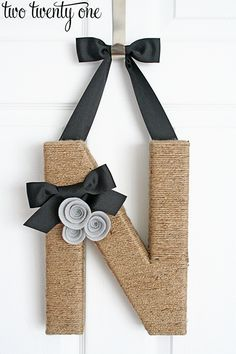An alternative to the letter you bought! we have that spool of jute rope. . With book paper roses ot burlap/linen roses