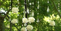 I love this idea.  Flowers and crystals could drip from branches for centerpieces, as an introduction into the reception, from a chuppah or arch for ceremony.