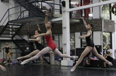 FILE - In this Nov. 25, 2012 file photo, Filipino slum dweller Jessa Balote, center, practices with other students during a class at Ballet Manila in the Philippine capital. Balote, who used to tag along with her family as they collect garbage at a nearby dumpsite, is a scholar at Ballet Manila's dance program. As an apprentice, she makes around 7,000 pesos ($170) a month, sometimes double that, from stipend and performance fees. (AP Photo/Aaron Favila, File)