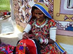 Rabari woman from northwest India doing beautiful embroidery work.