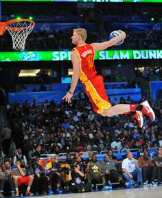 Chase Budinger soars for a slam in the Slam Dunk contest