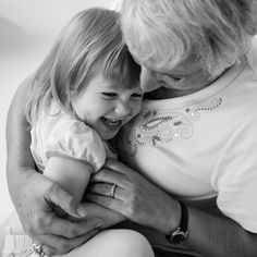 Grandparent photo- photo of a grandmother and her young granddaughter snuggling.  Photo by Meghan Hof, Denver portrait photographer.