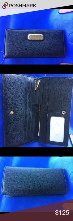 Brand new Marc Jacobs slim wallet Slim and elegant and still holds all your needs! Marc by Marc Jacobs Bags Wallets