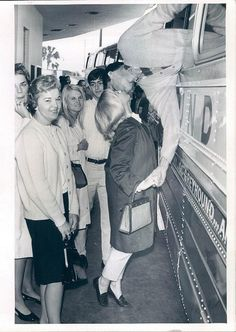 Amilitary manages to squeeze thru a window to kiss his girl, 1967 ©VintageImagePhotos