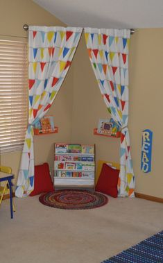 great idea for reading area in child's playroom - just hang curtain rod in the corner with some shelves, pillows, and a rug. by Lailah